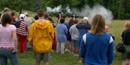 Visitors watch a musket firing program