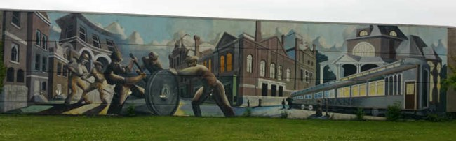 Mural of Pullman Workers, Pullman Car, and the Pullman Town.