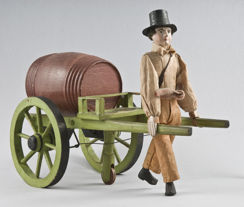 A mid-19th century cart toy with moving parts that belonged to Ernest Longfellow.