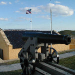 Interior of Fort Moultrie with an 18th-century cannon and an 1809 U.S. flag.