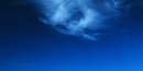 Image of blue sky with a white cloud