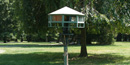 A large birdfeeder on the lawn of Glenmont just outside the conservatory.