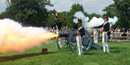 Fort McHenry Guard fires a cannon.