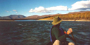 Person paddling down the Noatak River.