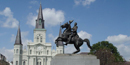 St. Louis Cathedral and a statue of Andrew Jackson on his horse in New Orleans' Jackson Square