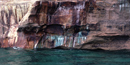 Mineral seepage creates the vibrant colors shown on this close-up photo of the Pictured Rocks cliffs.