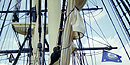 A view of the rigging of Friendship, looking up through the spiderweb of lines attached to the horizontal yards and vertical masts.