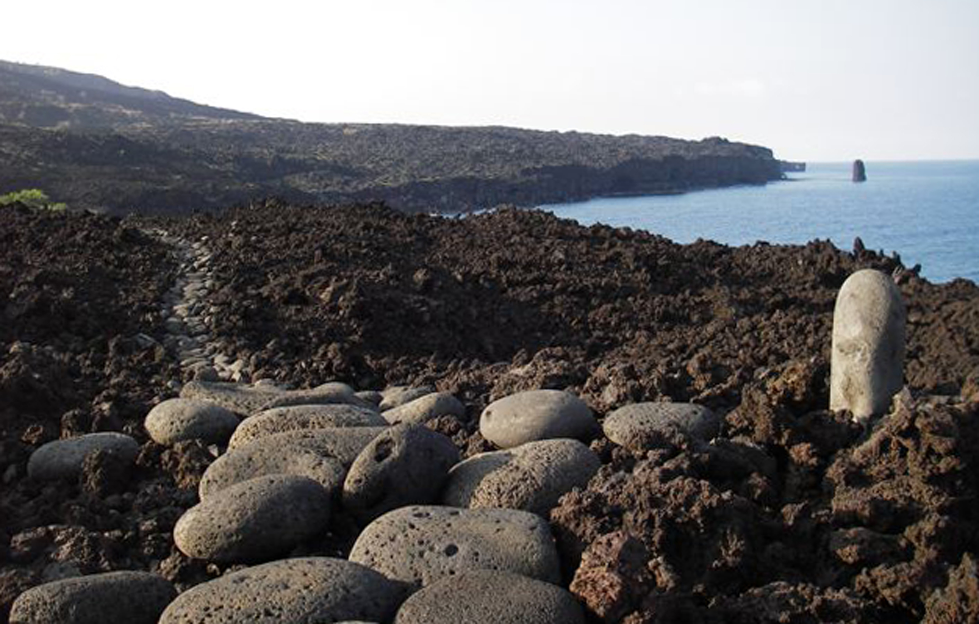 A waterworn stepping stone trail through a'a lava and next to the sea