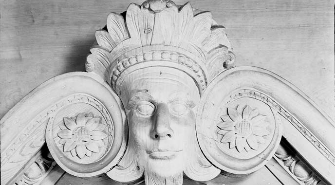 Detail of carved wood mask over the Assembly Room doorway.