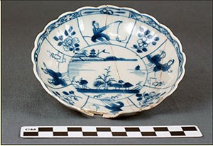 Photograph shows a blue and white Chinese  porcelain saucer discovered at the Dexter Site.