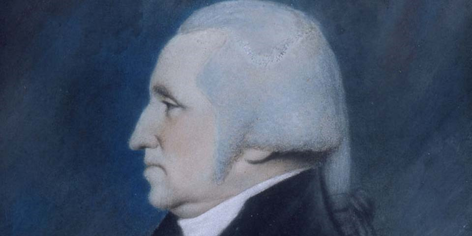 Color image of a detail of a pastel on paper of George Washington.  Washington is in left profile with powdered hair tied in a queue with a gray ribbon.