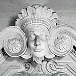 Scrolled pediment detail above the Assembly Room doorway.