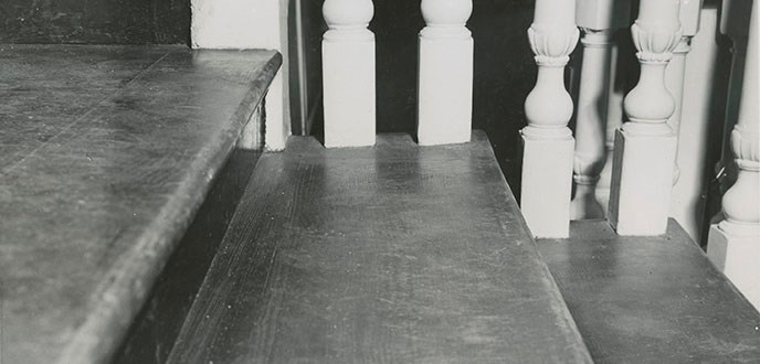 Photograph showing the newly replaced slip-in stair tread on Independence Hall's staircase.