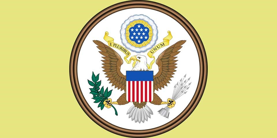 "Color illustration of the Great Seal of the U.S., showing an eagle holding an olive branch and arrows, with the motto ""E Pluribus Unum."""