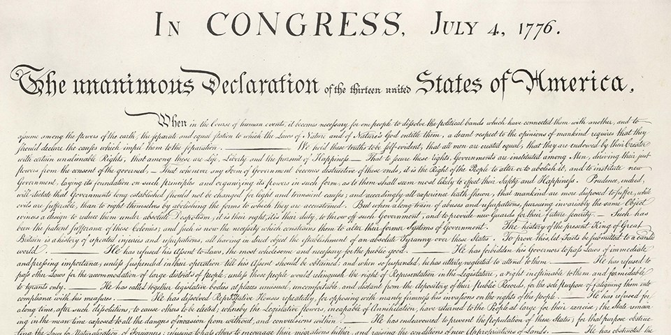Color image of the top half of the handwritten Declaration of Independence with brown ink on cream paper.