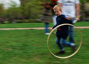 Budding Junior Ranger playing at rolling hoop near the Liberty Bell Center on Junior Ranger Day.
