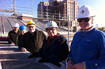INDE historical architect Charles Tonetti with construction team members