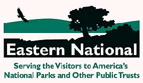 a company logo with green mountains lake and trees with the words Eastern National on it