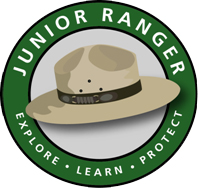 logo with the words Junior Ranger on a green ring and ranger hat inside that ring