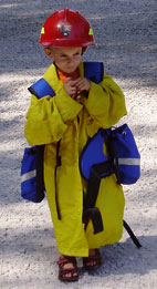 Child wearing wildland fire clothing