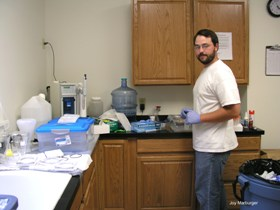 A PhD student from the University of Illinois works on methylmercury research in the GLREC lab.