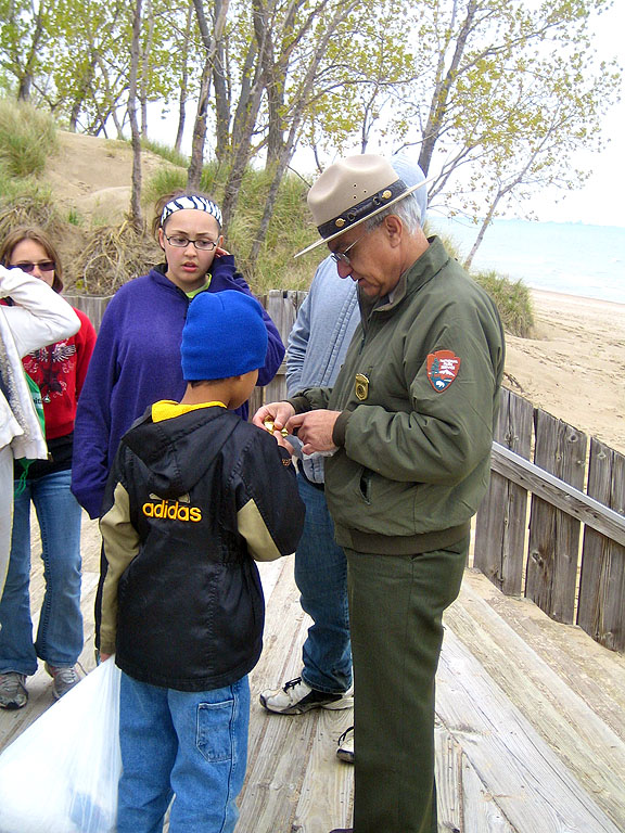 Park Superintendent, Costa Dillon, awards one of the first Great Lakes junior ranger badges.