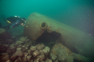 A diver explores wreckage from the shipwreck, Henry Chisholm.