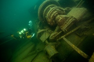 A diver exploring the shipwreck, Emperor.