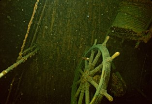 Remote operated vehicle photograph of the helm of the shipwreck, Kamloops.