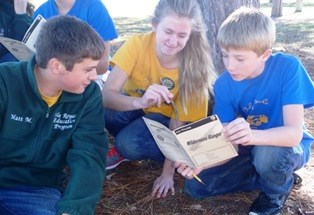 Youth work together on completing Wilderness Ranger booklet
