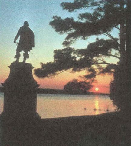 statue of Captain John Smith (located on Jamestown Island) in the sunset
