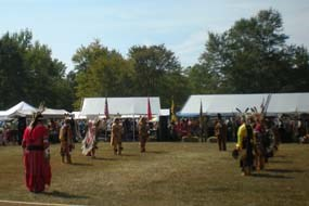 Opening ceremony with tribal members in regalia, including Chickahominy Chief Stephen Adkins, at the Annual Chickahominy Fall Festival and Pow-Wow.