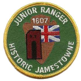 Circular Junior Ranger Patch showing the English flag of St. George, the Jamestown 17th Century Church Tower and the NPS Arrowhead