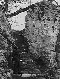 Man standing at the base of the stone staircase built by the CCC for Jewel Cave National Monument.