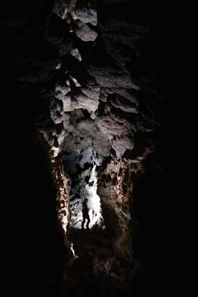 A caver in a large passage in Jewel Cave
