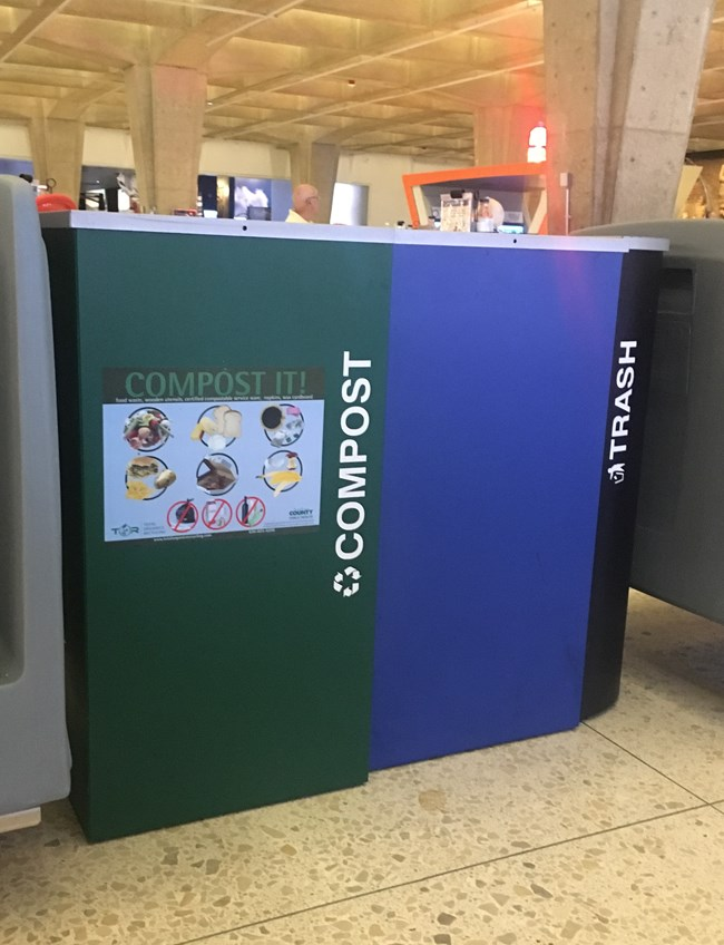bins located in the public spaces of the Arch Café that hold compost, recycling, and trash