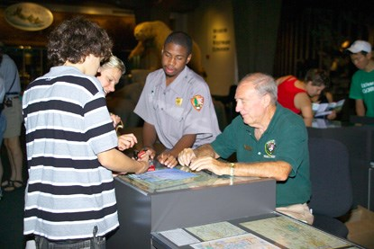 Volunteer giving information to a visitor at the Gateway Arch Visitor Center