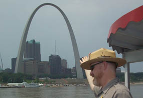 Park Ranger pointing at Gateway Arch from Riverboat