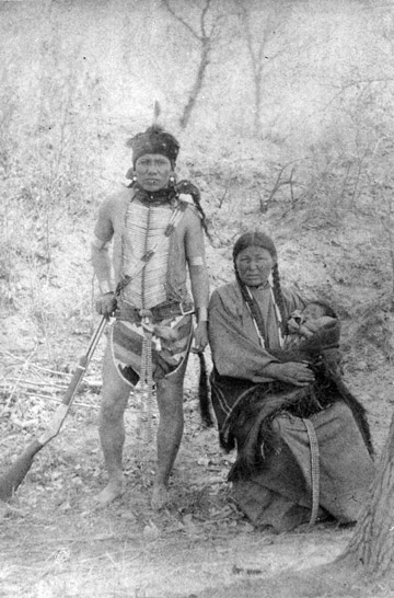 American Indian man and woman with a baby. V101-000012