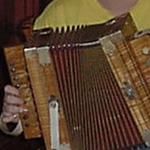 Image of hands playing an accordion