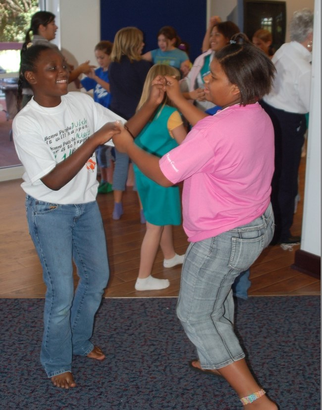 Girls learn to Cajun dance