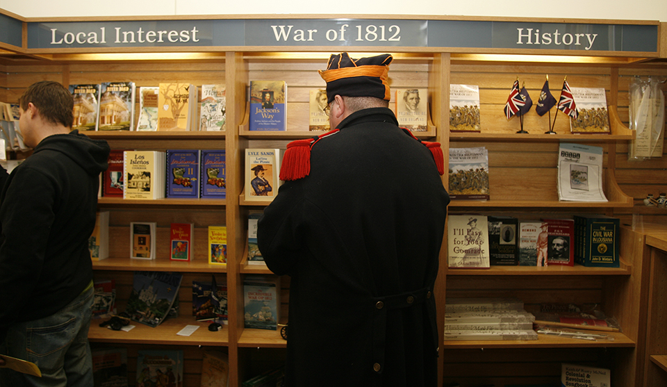 Man dressed as War of 1812 soldier shops in park store