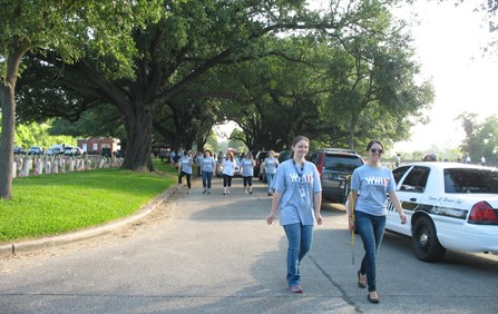 Image of volunteers in National World War Two Museum shirts at Chalmette National Cemetery