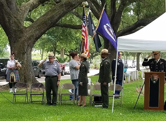 Memorial Day ceremony participants present a solemn salute