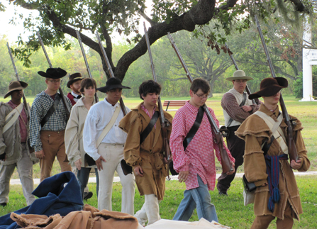 Image of high school students in 1815 period dress practicing military drills