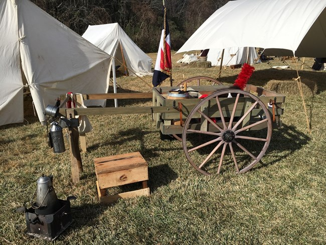 1815-era hand cart and other objects used by troops