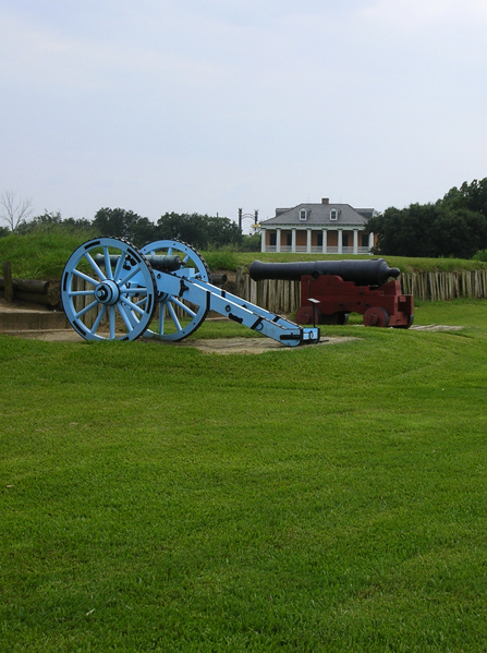 Image of battlefield with 1815 cannons and historic home in background