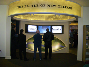 Visitors look at the orientation film and map at the Chalmette Battlefield Visitor Center