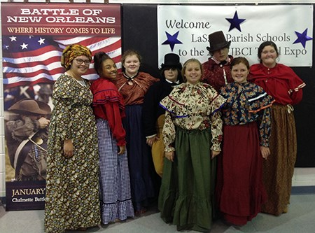 Eight Choctaw youth dressed in men's and women's attire of the War of 1812 era.
