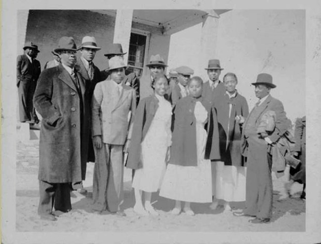 African American men and women in mid-1900s clothes